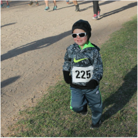 Child Participating in Step Up for KIDS Run