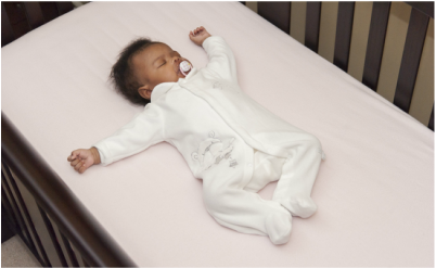 Baby Sleeping in Crib Image