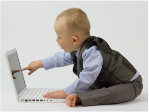 Baby Boy Touching Laptop Computer